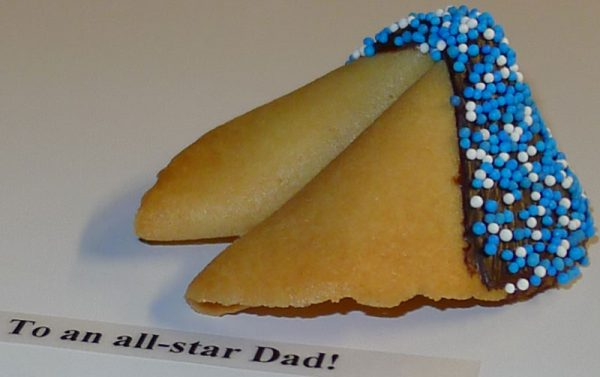 fortune cookie with chocolate and blue and white nonpareils