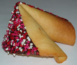 fortune cookie with chocolate and red, pink, and white hearts